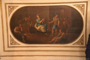 Una delle quattordici tavole ellittiche dipinte nelle spalliere dei sedili destinati ai confrati raccontano le storie della santa.